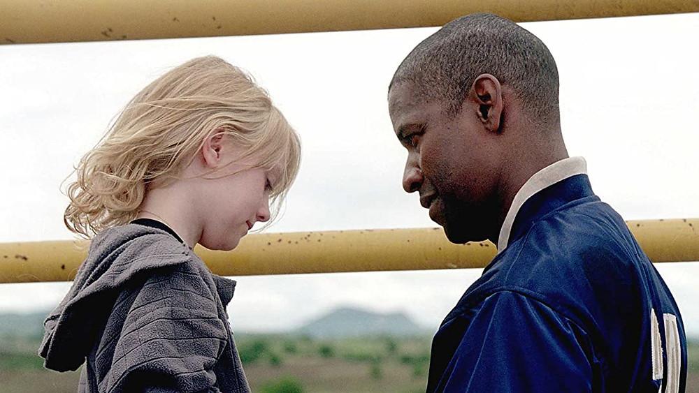 Dakota Fanning and Denzel Washington in Man on Fire (2004)
