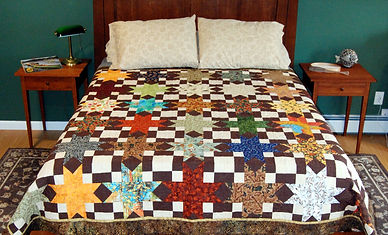 Quilt shown on a queen size bed.JPG