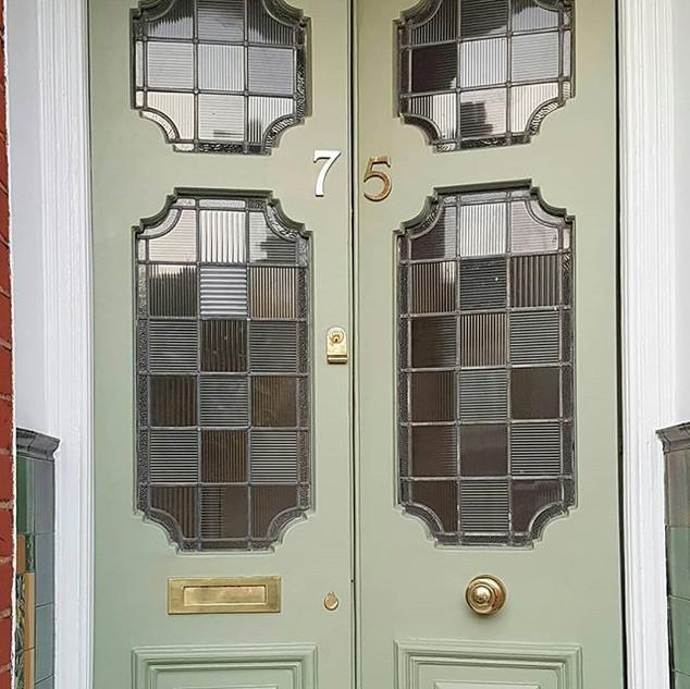 Front door repaired & finished in vert de terre