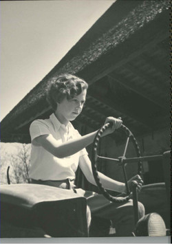 Elizabeth, as a girl, at the wheel