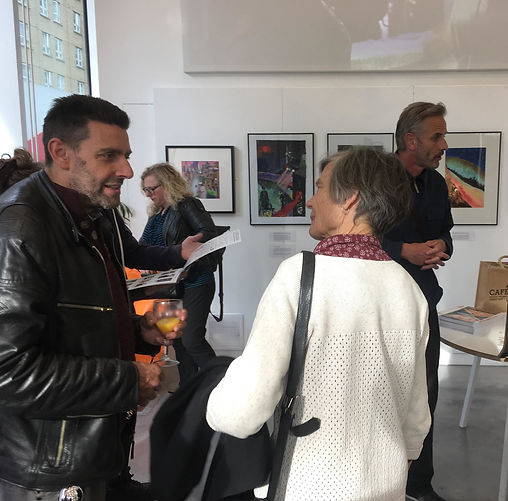 Photographer David Fussell speaks to Jen Burnham from St Mungo's at the opening of one of our exhibitions. This one was hosted by the Old Diorama Arts Centre, near Warren Street.
