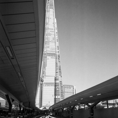 "NOVEMBER 2018: Trackside, Southwark: Hugh Gary took this shot of the Shard from London Bridge Station: ""I visited London Bridge to take a photo of the platform, turned around and seen the full length of the shard and thought the line of the platform canopy merges perfectly with the building."" Hugh is an ex-serviceman, having been deployed to Iraq and Afghanistan during his ten years with the British Army. He became homeless two years later: ""a lot of the homeless people in London are ex-service"". Hugh found shelter with West London mission's Big House, a hostel for veterans and is currently waiting for his own place through Stoll, who seek to rehouse veterans across London. He has now in his final year of a Photography degree, at the University of West London. Where he founded a photographic society, to support his fellow students. He has also started offering his photography skills to mentor young adults, some of which are homeless through the Pillion Trust and, Café Art and their partners."
