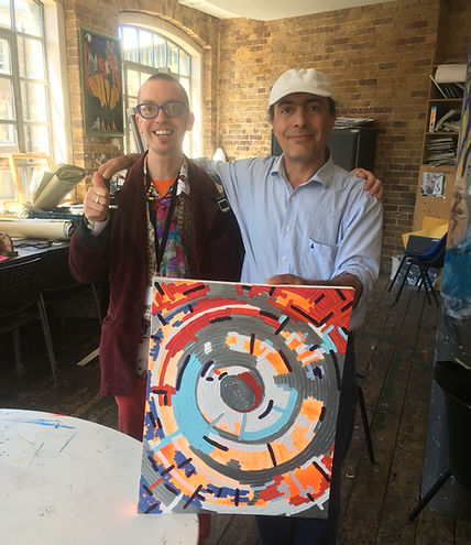We exhibit art by artists who go to London homeless charities art groups. This is Chris from Crisis with one of his artists.