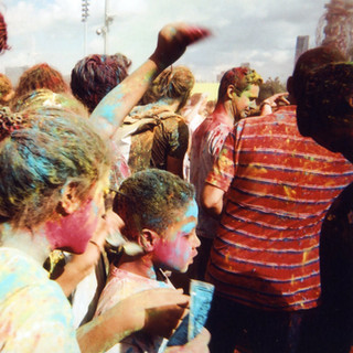 Photo by Goska Calik, chosen by public vote for December in 2016 My London calendar. Goska Calik took this shot during the Greenwich and Docklands International Festival in early July. The Colour of Time was a Holi-inspired event by Artonik and East London Dance who invited the Public to participate by throwing coloured powder. 'I started taking photos when I was five years old. The first photography I did was with my father. It was with a Zorky 12, a Russian camera. He taught me about light and the zoom and everything. I loved it. So then I bought my first camera and I started to take photos. It was a Beirette, a German camera.' Arriving in London four years ago, Goska found herself homeless when she lost her job due to illness. After sofa-surfing for several months she was finally directed to Crisis where she was helped to find a place to live. Goska is now studying counselling and working part time as a support worker with people with mental health problems. She goes to Cardboard Citizens, a homelessness support organisation where she participated in photography and a dance workshop.