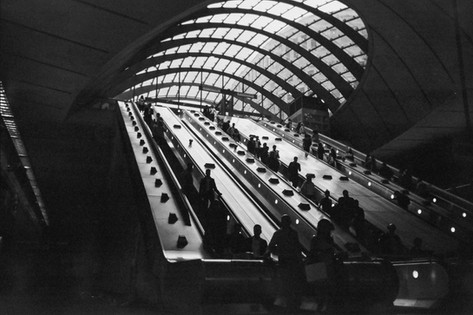 """APRIL 2018: Keep Moving, Canary Wharf: """"I wanted to capture the stillness on the escalator before they enter the fast pace outside"""", says Karina who took this shot in Canary Wharf Station. """"Bankers, tourists and the homeless on their daily routine."""" """"In school I was bullied which interfered with a lot of my education. Things where disrupting at home. I got removed from home at 14 and by 15 I was homeless. I ended up in shelters and never got permanent accommodations. Then I got help and was able to stay in a shelter. """"Sometimes we can get knocked off our path"""" says Karina who heard about the contest in the art class run by One Housing in Camden. """"We cannot stay down. We need to keep moving forward. If you feel your physical wellbeing is down then keep up your mental wellbeing. The battle will not be lost unless you accept defeat. I am grateful for the things around me. I keep everything moving."""""""