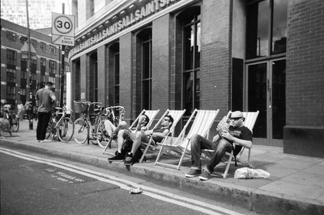 June in 2014 Cafe Art calendar. Simon Denis says this shot of a row of deck chairs in Shoreditch was taken on a hot summer's day: 'It was just one of those Sundays, everyone was just very relaxed.' He says he has been taking photos for four years now and says he used to have a digital camera but now just uses his phone. A former model in the 1980s, he had been a civil servant for many years before he first became homeless when he couldn't find a job. When he did find a job it was only a contract position with no security. After finding and 'building up a flat', he lost it just a year later, becoming homeless again. At this point he took up creative writing and digital media at The Connection at St Martin-in-the-Feilds church.