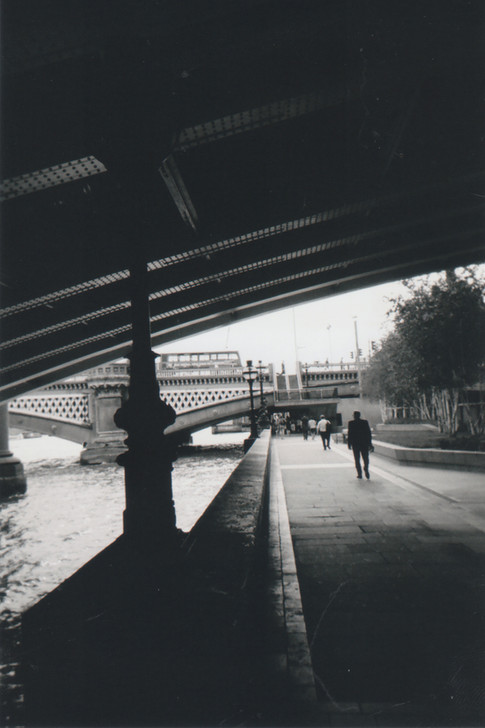 June in 2015 MY LONDON calendar. Photographer Aaron Little says 'I wanted something that looks like the one from those early French photographers. I pictured this in black and whote so I'm really pleased. I wanted to have shots that are what I see when I'm walking around London. I'm pleased that it actually shows some depth and the bridge structure.' Originally from Berkshire, Aaron has never envisioned living in London but finds that it has really helped him creatively, giving him access to a lot of visual stimuli. Aaron has been coming to Crisis for several years. 'It's been rewarding and helped me cope with various financial issues. Art for me is a wonderful outlet to express myself and to get what I want to say out on the canvas or in the photograph.'