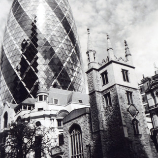 Photo by Ioanna Zakana. May in 2016 My London calendar. Third Place, People's Choice. 'I liked the sky, it was amazing that day,' says Ioanna Zagkana about her photo of 30 St Mary Axe, known as 'The Gherkin', and St Andrew Undershaft. She feels they represent the future and the past of London. The Gherkin was built in 2003 and its elderly neighbor built in 1532, survived not only the Blitz but also the Great Fire of London. Coming from an island in the Mediterranean Sea, Ioanna has been living in London for almost five years. She was a dancer until an accident ended her career. She then worked as a self-employed therapist until ongoing health problems meant that she could not continue. When she ran out of money she lived in a squat in Whitechapel before she heard about Crisis. She goes to many art groups, including Crisis Skylight and Women at the Well. She is currently staying with a friend. She believes that not enough people live in the present: 'We are not grounded', and it is her goal to be so.