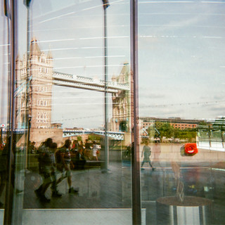 """DECEMBER 2018: Tower Bridge reflection, Southwark: Christopher McTavish took this shot of Tower Bridge reflected from a City Hall was a follow-up to his winning shot of St Paul's cathedral last year. """"My photography is full of reflections and shadows. It was nice to see the view that the mayor of London has."""" Christopher belongs to the Choir With No Name, a choir set up for people who have experienced homelessness. From a small town east of Toronto, Canada, he came to London in 1971, originally intending to stay """"for summer"""". In 1998 and 1999 he was homeless in London but he is now living in a housing association flat in Chelsea. Christopher says he was adopted and this background has motivated him to volunteer for a Chinese adoption charity, helping people from overseas to adjust to the UK. He speaks Mandarin, German, Spanish and French."""