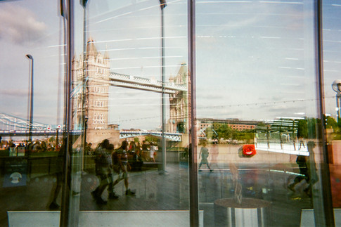 "DECEMBER 2018: Tower Bridge reflection, Southwark: Christopher McTavish took this shot of Tower Bridge reflected from a City Hall was a follow-up to his winning shot of St Paul's cathedral last year. ""My photography is full of reflections and shadows. It was nice to see the view that the mayor of London has."" Christopher belongs to the Choir With No Name, a choir set up for people who have experienced homelessness. From a small town east of Toronto, Canada, he came to London in 1971, originally intending to stay ""for summer"". In 1998 and 1999 he was homeless in London but he is now living in a housing association flat in Chelsea. Christopher says he was adopted and this background has motivated him to volunteer for a Chinese adoption charity, helping people from overseas to adjust to the UK. He speaks Mandarin, German, Spanish and French."