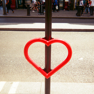 "Love heart bike stand by Ella Sullivan: February 2017 in MyLondon calendar and in 2016 exhibition. ""I was in New Bond Street when I happened to notice this love heart bike stand and thought it would make a great picture as it was giving out a message of love and providing a safe place to lock up your bike ."" Born in London, Ella Sullivan grew up in County Kerry, Ireland. She returned to London over 20 years ago and now lives in Islington. Ella says she sometimes takes photos on her phone, but doesn't have a real camera. She goes to art sessions run by SHP near Essex Road, Islington. ""I've been going to SHP art group for over a year now. I was having some problems with my housing so that was why I got referred to SHP. I've had good support from them."" She is also doing a course with the London Hairdressing Apprenticeship Academy in Camden. ""I finished doing the hairdressing course last year so now I'm working on the barbering side of it doing men's haircuts."""