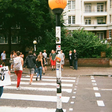 August in 2014 Cafe Art calendar. This zebra crossing, made famous by the Beatles' 1969 album Abbey Road, was photographed by John Spencer. Probably the most frustrating crossing in London from drivers, as there is a steady stream of tourists taking photographs of each other, John thought it would be a good place to take contest photos.