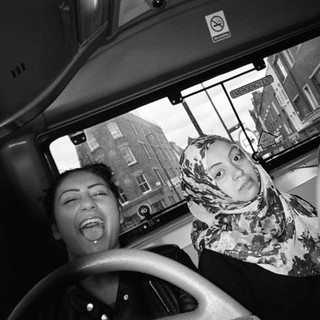 January in 2014 Cafe Art calendar. 'It's just my friends Joe and Warda on the bus'. Photographer Afii, 19 says she likes taking photos and giving them to her friends. She was homeless for five months before moving into the St Mungo's women's hostel in Hackney. Before she was accepted into the hostel she was living in friends' sofas and anywhere she could sleep safely, including park benches, hospitals and on buses. She explains that she was exhausted when she arrived at St Mungo's. Now that she is feeling rested she is focusing on her future, including doing an early years childcare apprenticeship course.