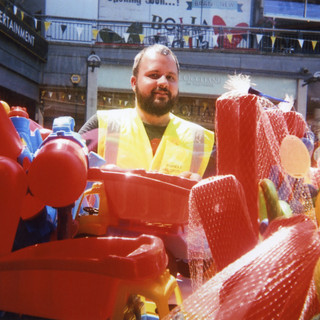Photo by Frances Whitehouse, 2015 My London Exhibition. Frances Whitehouse says: 'This is Tom, a local cleaner that I know from my area and I was in a shop looking at all these toys. I did it so they are in the foreground – they are larger than him! So it's a bit of juxtaposition.' Frances, who has suffered from Post Traumatic Stress Disorder in the past, left home when she was really young because she had a violent childhood. 'I lived in a pipe for some time.' Since volunteering with SHP she has found a new partner and is much more happy. 'I've been having counselling. Now I'm finally feeling like I've made progress. Frances, who got an A in art at college and a diploma in shoe design, has paintings Café Art's art in café programme. 'I hadn't done art for some time and they helped me realise my potential. When you are unhappy you disassociate yourself from reality and Café Art has helped me feel valued again by giving me confidence, because of my art. Now I value everything I draw or see.'