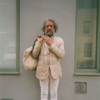 September in 2015 MY LONDON calendar. 'I met Pip on Liverpool Road' says Alex Davies. 'He said he's been wearing cream for all of the summer and he certainly looked like he's had those clothes on for quite a long time.' Alex says Pip closed his eyes intentionally just as the shutter clicked. 'I wanted him to keep his eyes open, because they were so blue.' Alex has been going to the Ten Feet Away art group at Margins in Union Chapel since April 2013. She says it's been a regular place to go and develop her 'creative practice' through photography and painting, adding that painting Pip would be an interesting challenge. 'In the art group people are kind and encouraging', says Alex. 'They are a talented group of people.' She also likes to photograph dogs in her local park and then paint them at Margins.