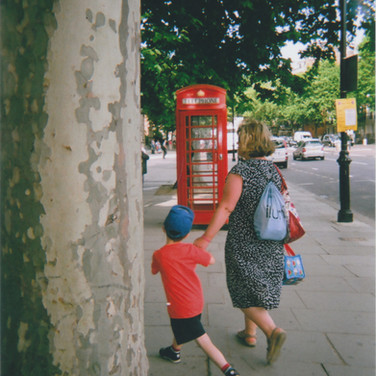 Agnes had been to the Victoria and Albert Museum. 'As I was coming up to the Natural History Museum I turned around to look at the London telephone box because it's iconic. I was trying to place it with the V & A when this lady and little boy came into the picture. I thought it looked interesting because it gives human interest in front of the telephone box. So it was an accident and it happened very quickly.'