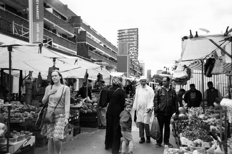 """The Market by Goska Calik: In 2016 MyLondon exhibition. """"It's at the market in the morning, and that's the place where I do shopping. It's at the market next to Commercial Road"""", says Goska Calik. """"I was on the way to work and they just stopped in the middle and took out my camera. Last year Goska had the winning photo as chosen by the judges and joined the RPS photography mentoring group. She says she gains a lot from it, """"especially for meeting people and taking photos."""" She also enjoyed meeting people that share the same passion for photography. """"Yesterday I went along with Frances to take photos. That is the most important thing to not just go home and be alone there."""""""