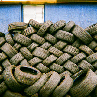 "Tyre pile by Mia Lyons: In 2016 MyLondon exhibition. Mia Lyons took this photo in a car repair garage just off Truro Road, Palmers Green, London. ""Maybe it's a bit too deep but I thought about our consumerism and how much we throw away and use and that we have to become more kind as a society and kinder to the earth that we live from. But now we know and we can change our behaviour, it's nothing negative it's just making people more aware."" Mia is originally from Hamburg, Germany and has lived in London for six years. She says the last time she took photos was when she was 14. She teaches pottery at Haringey Recovery Centre, which she describes as a supportive environment. ""I see it as my oasis. I was a client I started a dual diagnosis and I went there for counselling. My best friend was homeless and now she lives in a hostel. We have so much in common we stick together and we help each other out."""