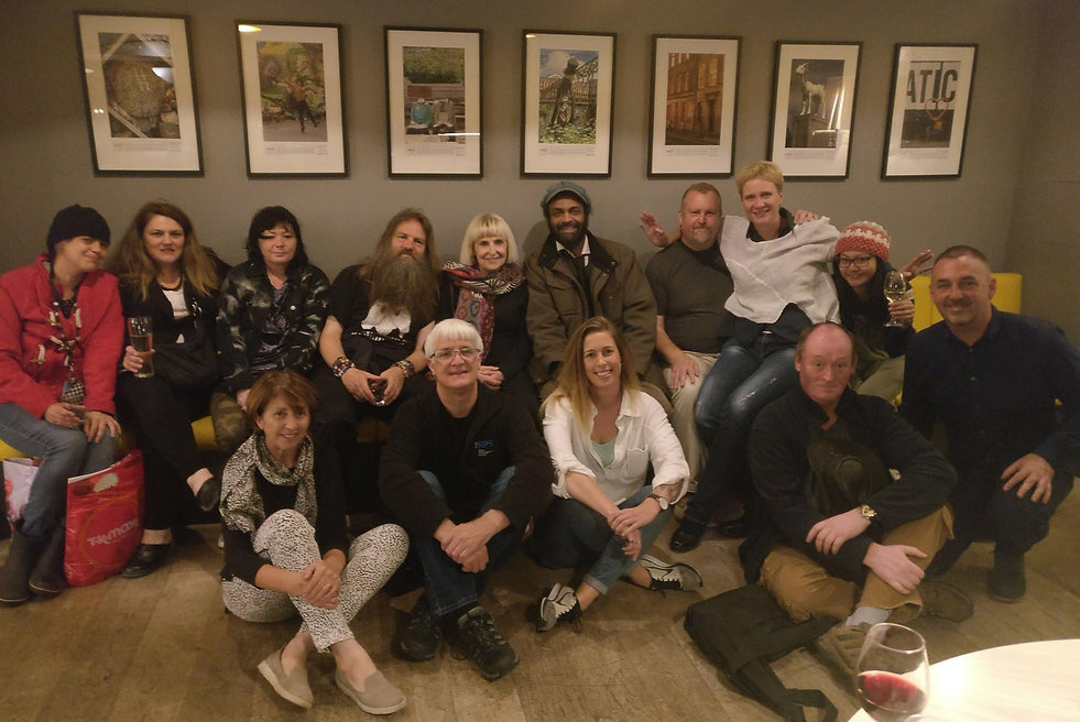 This is a group of Café Art's photographers at the launch of their exhibition in the Qbic Hotel, London, in 2017.