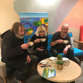 Three of our artists enjoying a cuppa at