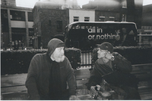 """February in 2015 MY LONDON calendar. Steve and Tony sit on this Islington Green bench often, says Amadeus Xavier Quadeer. 'I gave them an incentive: """"If I win a prize, you get 20% - and they were up for it! So the words on the bus are quite appropriate!' Amadeus, who originates from the Midlands but has lived in London since the '60s, says art is therapeutic, adding it calms him and allows him to interact socially with all types of people. His UK clothing business was affected by production moving offshore. 'I was a home-owner but my house got repossessed. When I was homeless SHP helped to re-house me in 2010.' He says he made that emotional investment during his divorce which his dad warned him against: 'Never argue, always go for the draw. I didn't take his advice and I lived to regret it but I've learned since that you should look forward and not back.' He's got a son in Lewisham who he sees regularly."""