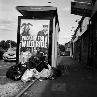 May in 2014 Cafe Art calendar. Krzysztof Wlodarczy could not ignore the message. 'There's the rubbish, and above it is the commentray.' The shot was taken on Bowes Road on the North Circular between Haringey and Enfield, North London. 'Every day it's the same, mayby only Monday and Tuesday every week is it clear,' says Krzysztof, who goes to St Mungo's Broadway's art group in Shepherd's Bush. 'I am showing the other London, not shown in the guidebooks, albums or postcards.'