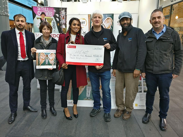 Santander presentation of cheque to Cafe Art