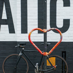 "In 2015 Hackney based artist Graham McLoughlin, Cyclehoop and the British Heart Foundation teamed up to place 14 #HeartsOfLondon cycle stands across Central London. This installation was designed to promote cycling in the city, celebrate British design, and raise awareness for the work of the British Heart Foundation. Photographer Geraldine Crimmins was homeless a few years ago and now volunteers with Café Art. ""I'm from Dublin but I arrived here a long time ago and I live in a housing association flat now."" Geraldine has had winning photos in Café Art's annual MyLondon photography contest and is a member of their photography mentoring group run by The Royal Photographic Society. Copyright: 2017 Qbic Hotels & Cafe Art"