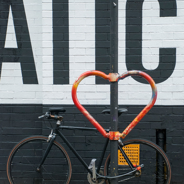 """In 2015 Hackney based artist Graham McLoughlin, Cyclehoop and the British Heart Foundation teamed up to place 14 #HeartsOfLondon cycle stands across Central London. This installation was designed to promote cycling in the city, celebrate British design, and raise awareness for the work of the British Heart Foundation. Photographer Geraldine Crimmins was homeless a few years ago and now volunteers with Café Art. """"I'm from Dublin but I arrived here a long time ago and I live in a housing association flat now."""" Geraldine has had winning photos in Café Art's annual MyLondon photography contest and is a member of their photography mentoring group run by The Royal Photographic Society. Copyright: 2017 Qbic Hotels & Cafe Art"""