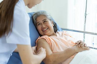 patient with nurse.jpg