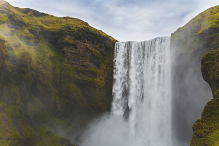 background image of a towering waterfall