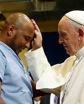 Pope Francis blesses a prisoner.jpeg
