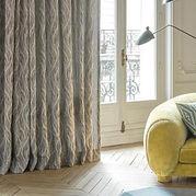 balcony doors with grey sheer curtains
