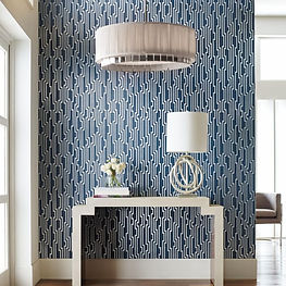 blue and silver modernwallpaper with white light fixtures, trim and table in bright entrance, york wallpaper, candice olson wallpaper