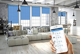 contemporary loft with blue automated roller shades operated from smartphone