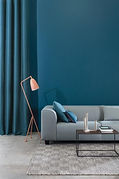 livingroom with grey couch and teal curtains