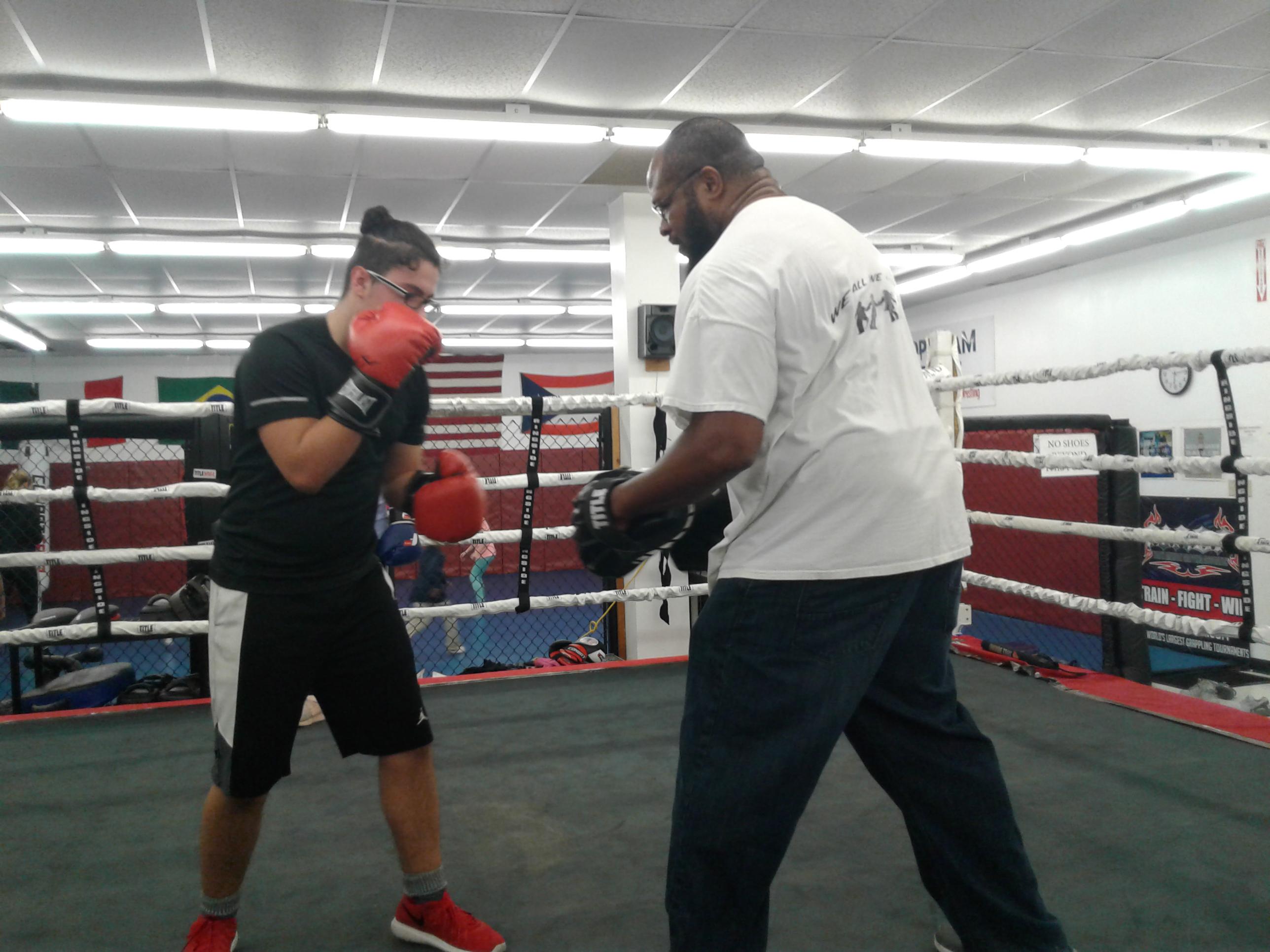 Lamon teaching at gym.jpg