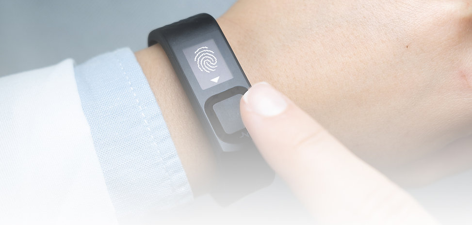 Closeup image of a worker's finger hovering over the fingerprint sensor of the Nymi Band.