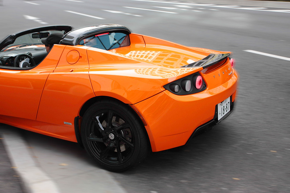 An orange Tesla Roadster