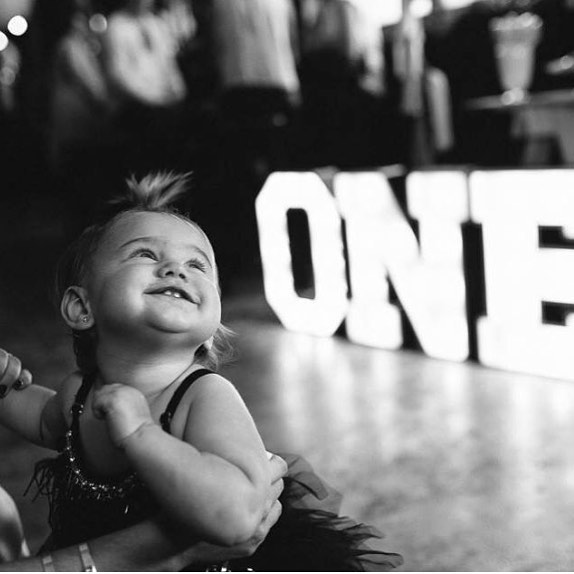 Cuteness overload! Check out little Ezra-Rose loving turning one! #one #birthdaygirl #marqueelights