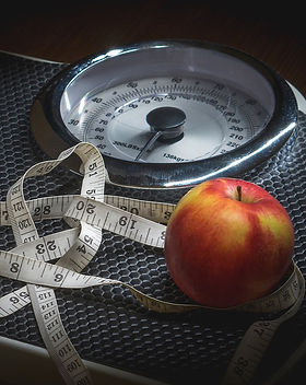 scale for weight management with an apple on it