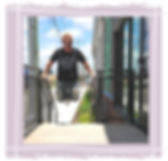 optima health and wellness coach wearing a health coach shirt hanging on a rail