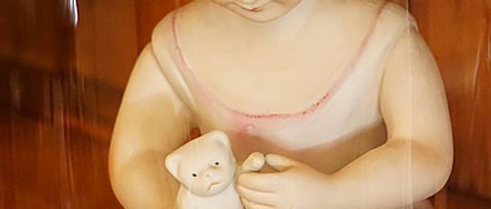 Bisque Piano Doll