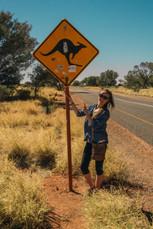 Chloe against a sign
