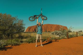 Henry holding bike up