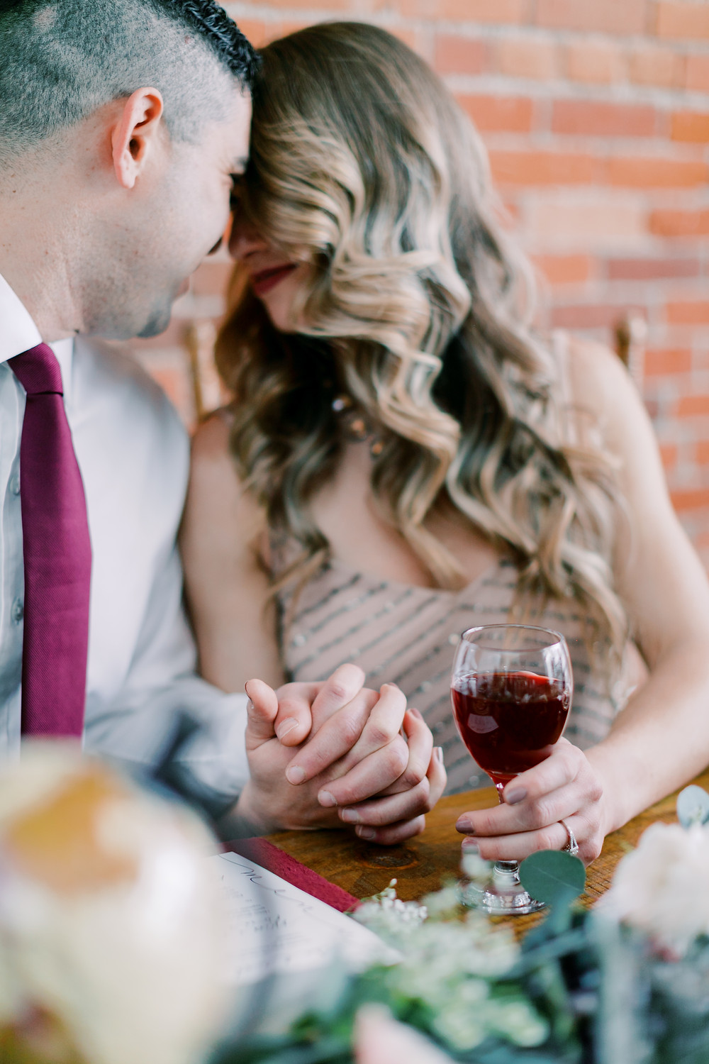 engaged-couple-sipping-wine.jpg