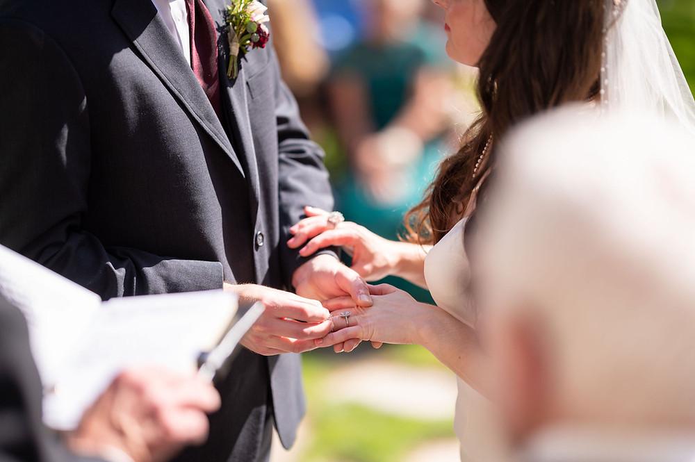 groom-putting-ring-on-brides-finger.jpg