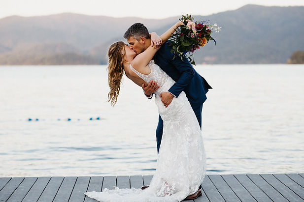 Couple kissing on dock in Idaho