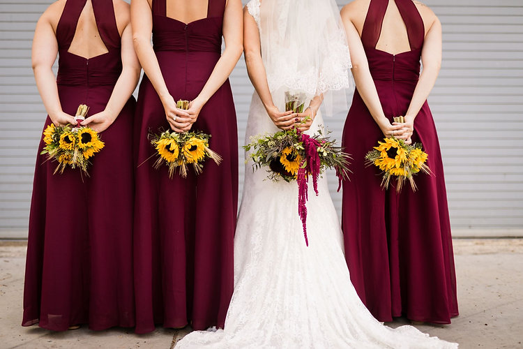 Bride and bridesmaid picture with bouquets