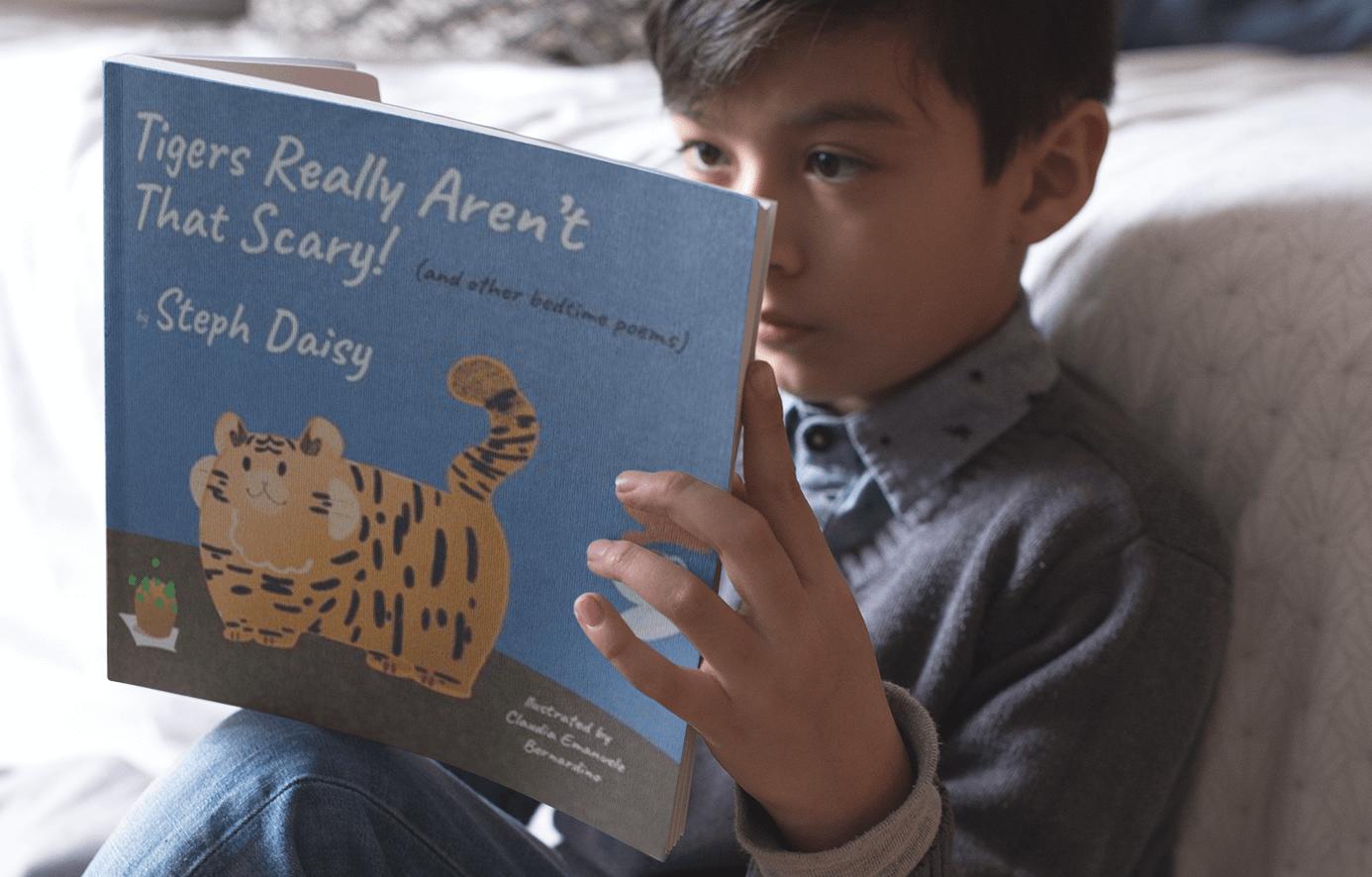 Boy reading tigers